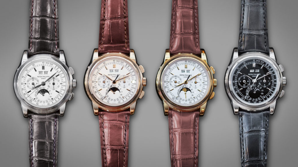 (From Left) A complete set of reference 5970s sold by Christie's in white gold, rose gold, yellow gold and platinum, the latter with distinct tachymeter scale