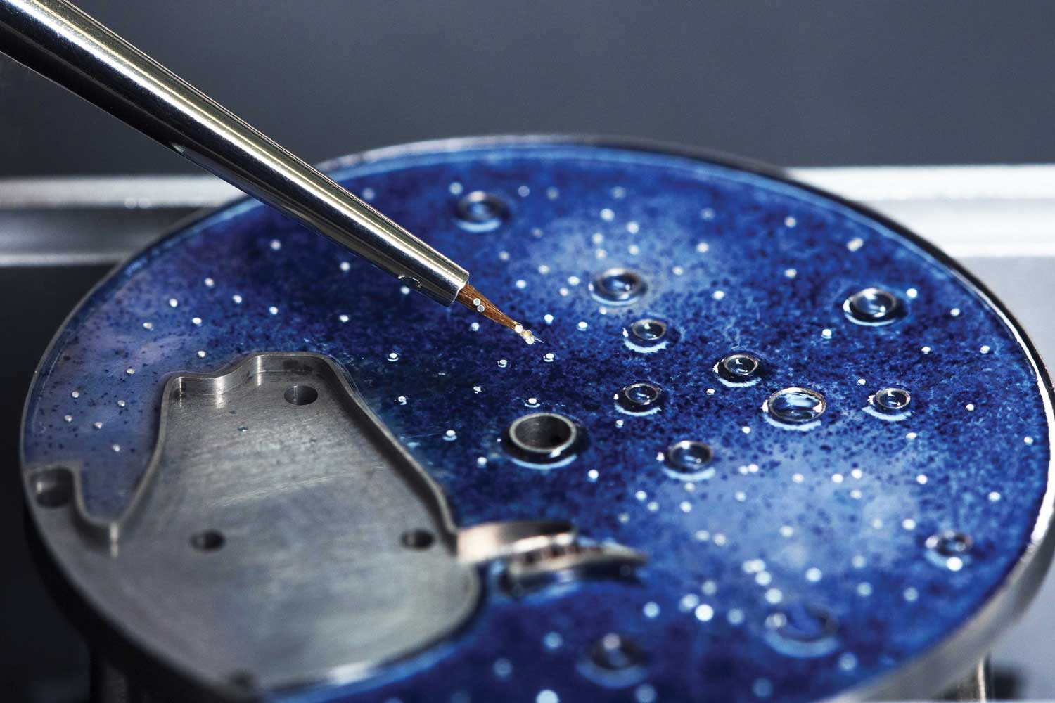 The deep blue enamel dial features white gold sculpting and colored enamel accents