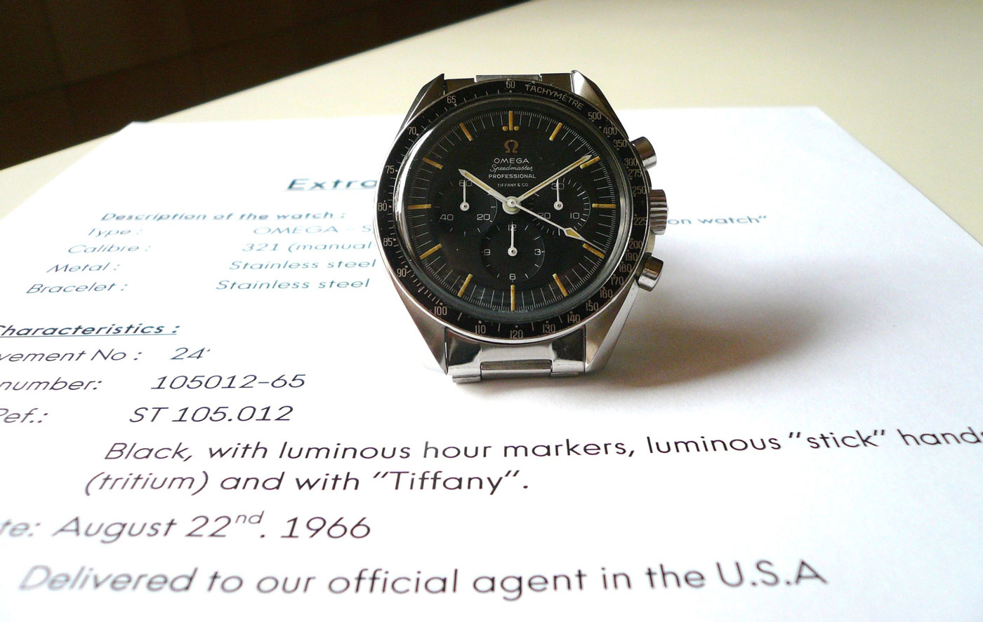 A Tiffany stamped Speedmaster ref. 105.012 with extract from Omega certifying its authenticity (Image from omegaforums.net posted by doctor steel)