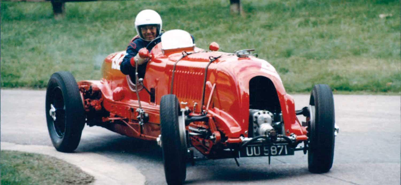 """Daniels driving his """"blower"""" Bentley at Prescott Hill"""
