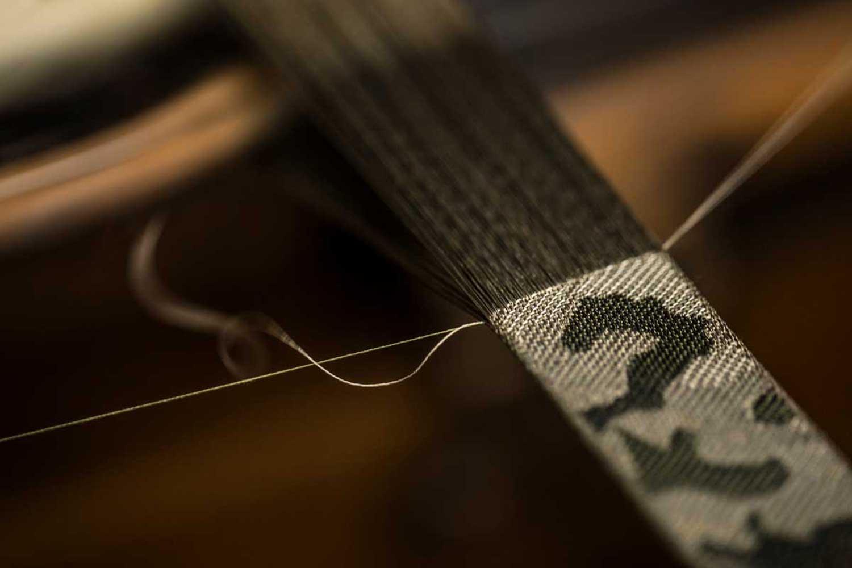 Camo strap being woven for the Tudor Ranger