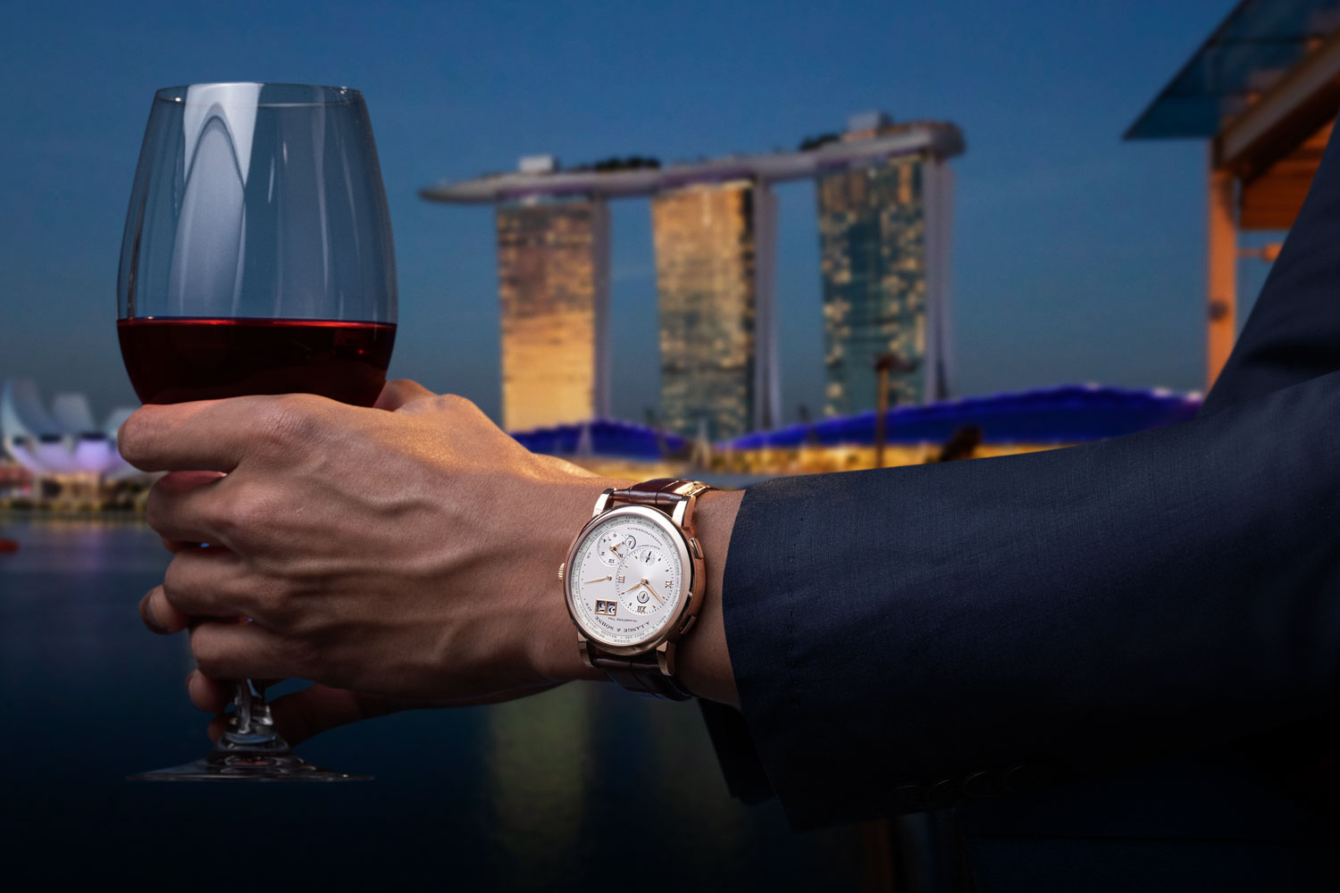"The Lange 1 Time Zone ""25th Anniversary"" set against Singapore's Marina Bay (Image © Revolution)"