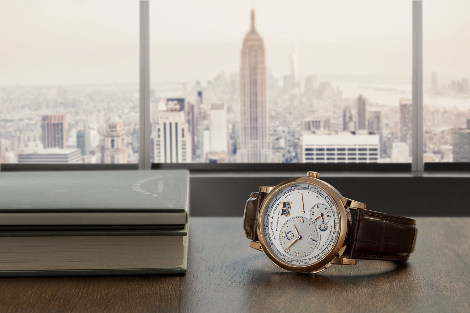 The Lange 1 Time Zone in pink gold set against New York City (Image © Revolution)