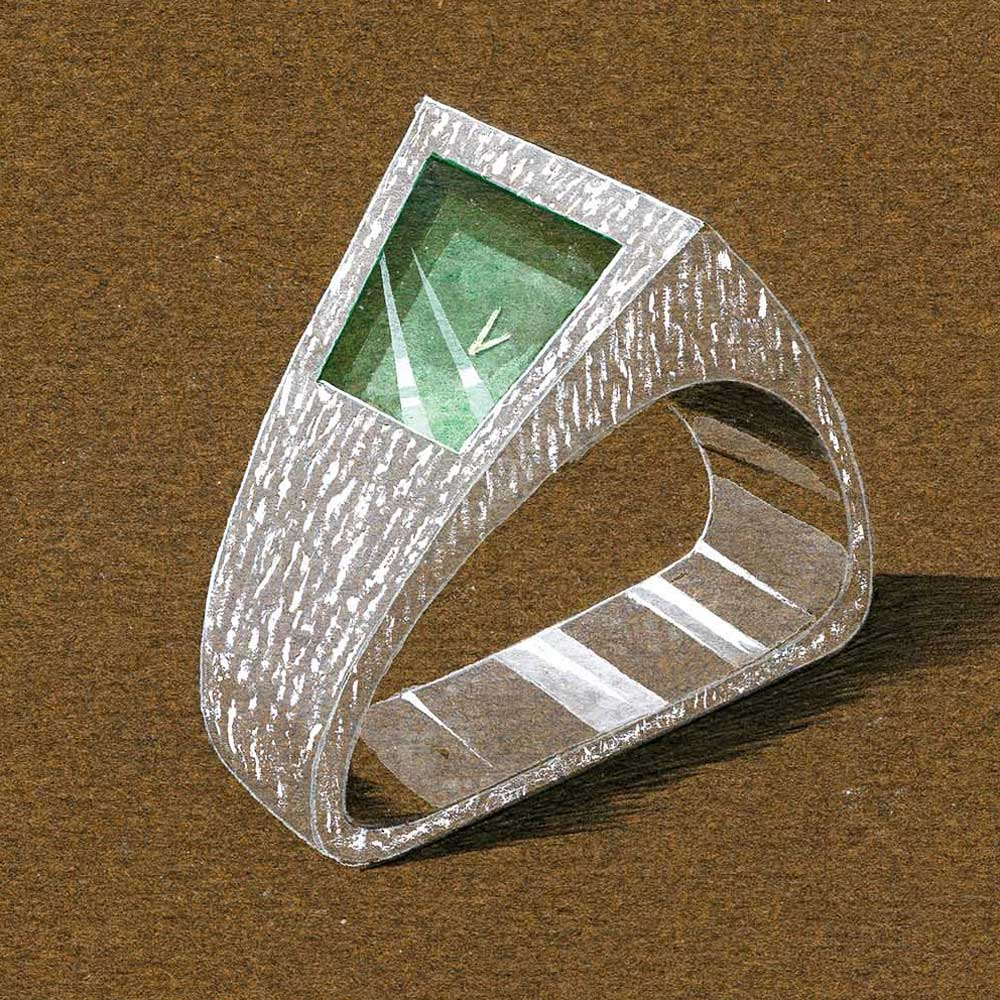 ...This being Grima, the rectangular face is offset, embedded in the thick, bevelled gold bracelet and is cut from a rich green tourmaline