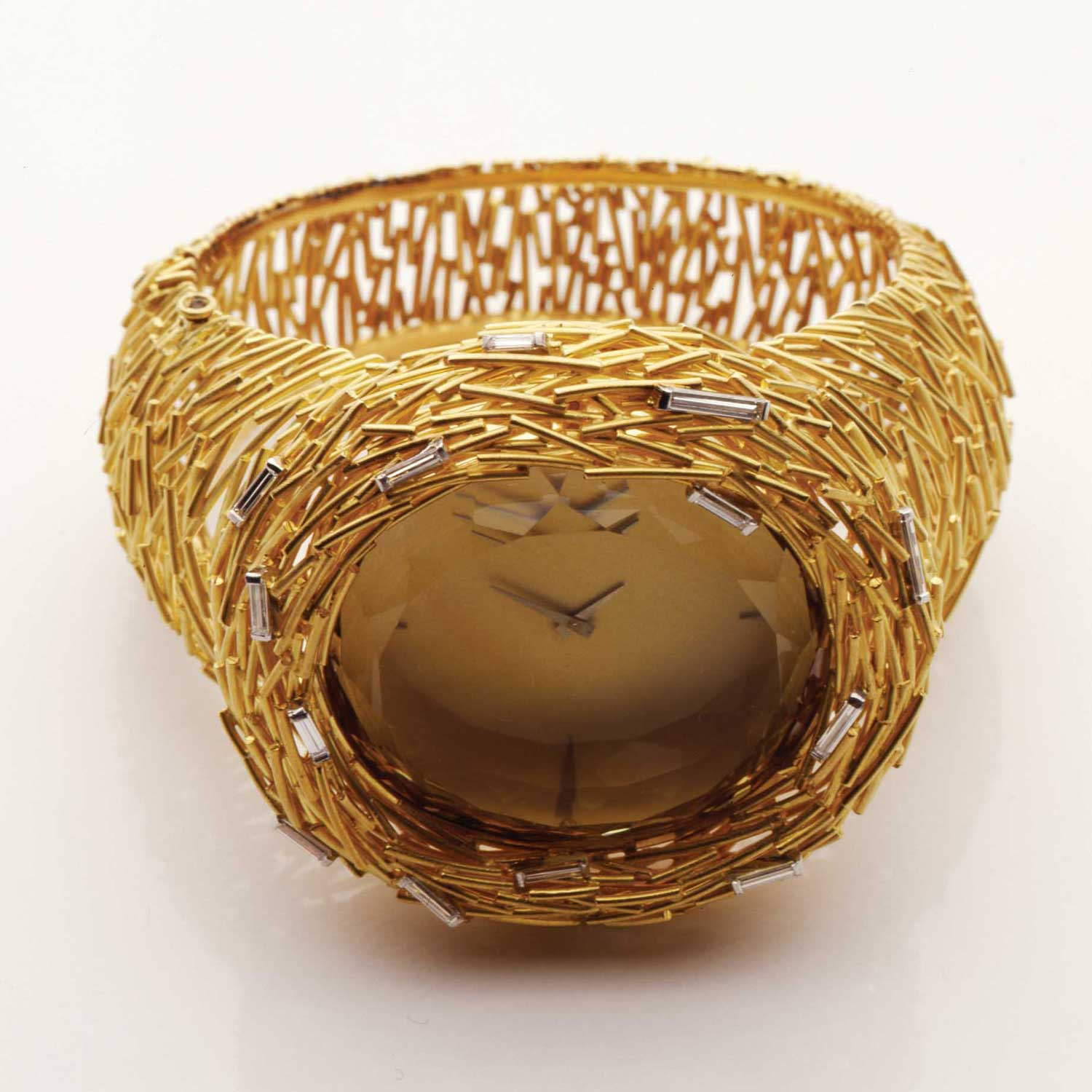 Also known as Matchstick, the Cerini watch is an example of Grima taking relatively humble forms such as the aforementioned pencil shaving or the piece of lichen that Princess Margaret brought back from the Balmoral estate to be cast in yellow gold. The vivid yellow citrine is a magnificent stone around which Grima weaves a basket of yellow gold matchsticks that sit on top of a bracelet of irregularly interlinked matchstick motifs. Grima famously used white diamonds as accents rather than principal stones