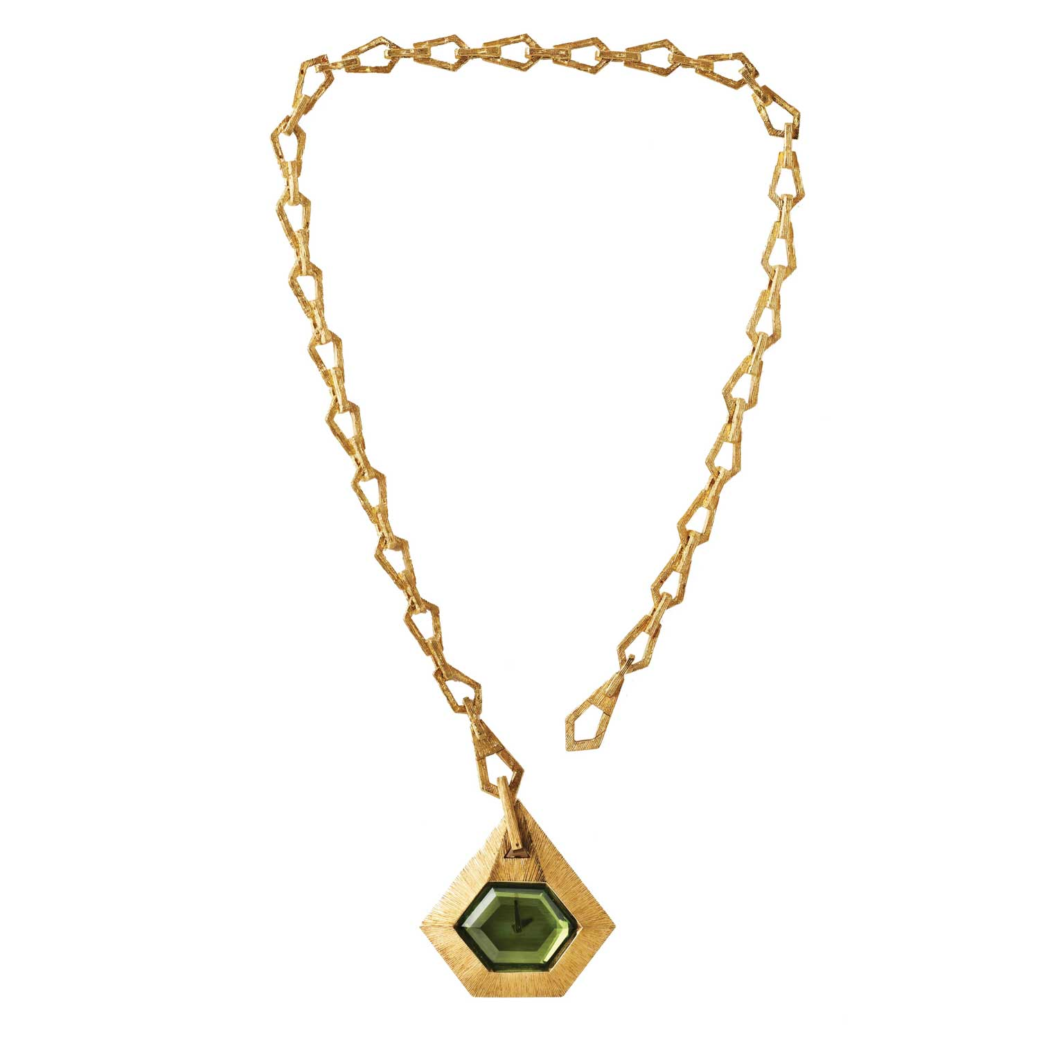 A substantial table-cut green peridot forms the centerpiece of Clover: a ladies' pendant watch that is an exercise in symmetry. The textured yellow gold case that frames the peridot could have been made with a brooch setting. Instead, it is suspended from large diamond-shaped textured gold links. The chain is articulated to sit as a pendant but could equally serve as a man's pocket watch