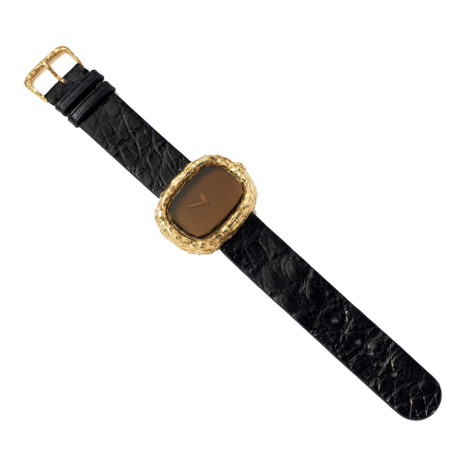 Teak is arguably the most personal Omega About Time design because it was the watch Andrew Grima wore until his death in 2007. Jojo Grima now wears the handsome unisex timepiece with smoky quartz face, rectangular beveled gold case and integral chocolate crocodile strap...