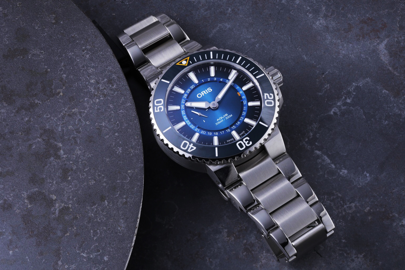 Revolution shines a spotlight on ocean conservation on World Oceans Day with Oris. Shown here is the Oris Aquis Great Barrier Reef III limited edition supports the Reef Restoration Foundation. Image shot by Sidney Teo for Revolution.