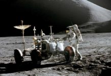 Astronaut James B. Irwin, lunar module pilot, works at the Lunar Roving Vehicle during the first Apollo 15 lunar surface extravehicular activity (EVA). This was the first time a rover was used in space exploration