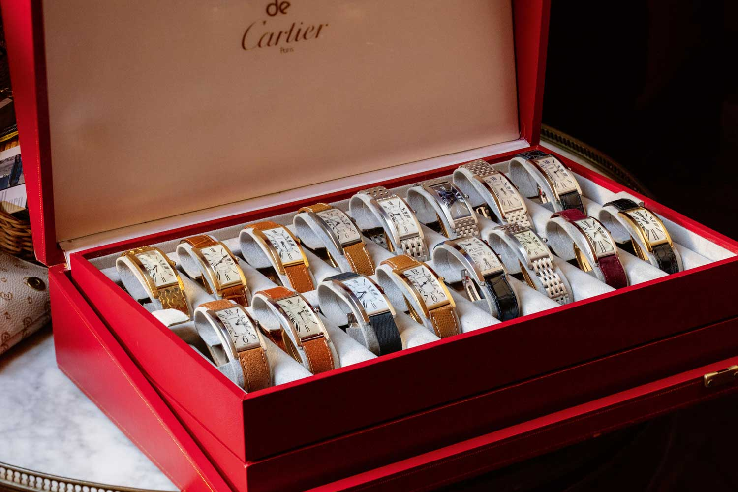 Some of Auro Montanari's Tank Cintrées, in a Cartier box, showing the evolution of the watch line (Image © Revolution)