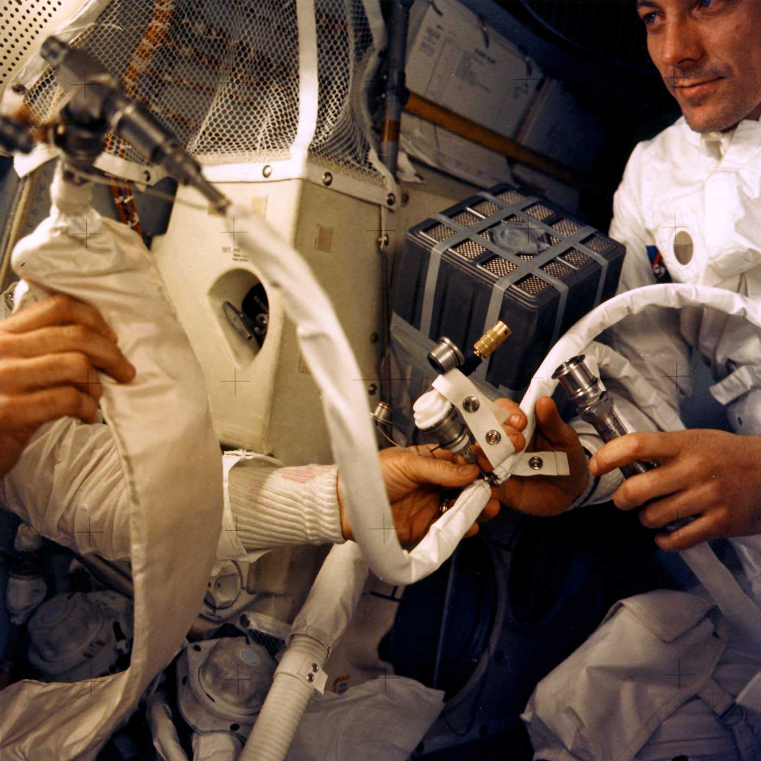 Interior view of the Apollo 13 Lunar Module (LM) during the journey back to Earth, showing some of the temporary survival apparatus rigged up with instructions from ground control staff. (Image: NASA)