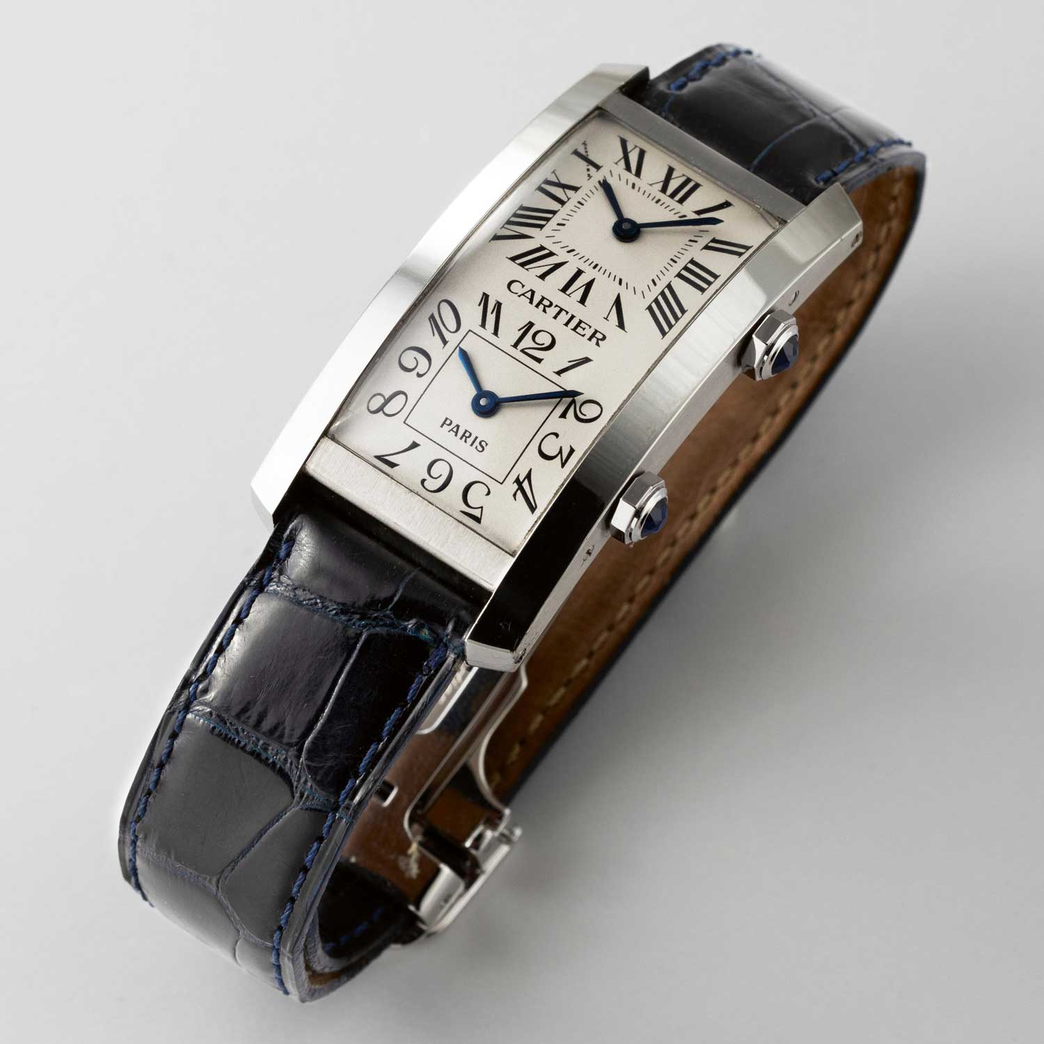 Rare Cartier Tank Cintrée dual time zone watch, driven by two small movements with Arabic and Roman numerals on the two dials (Image © Revolution)