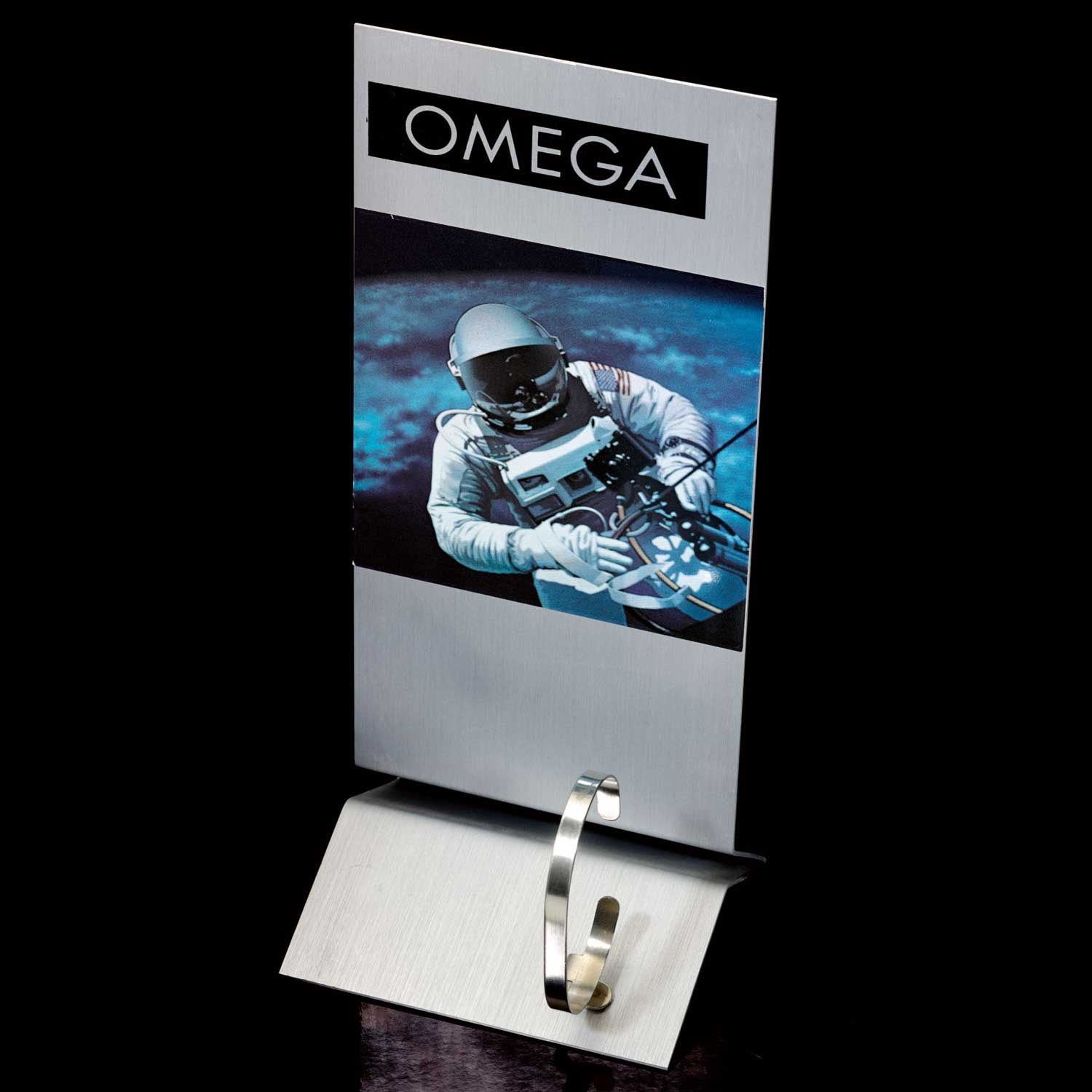 Lot 46: Stainless steel Omega adjustable watch stand depicting an astronaut, circa 1995