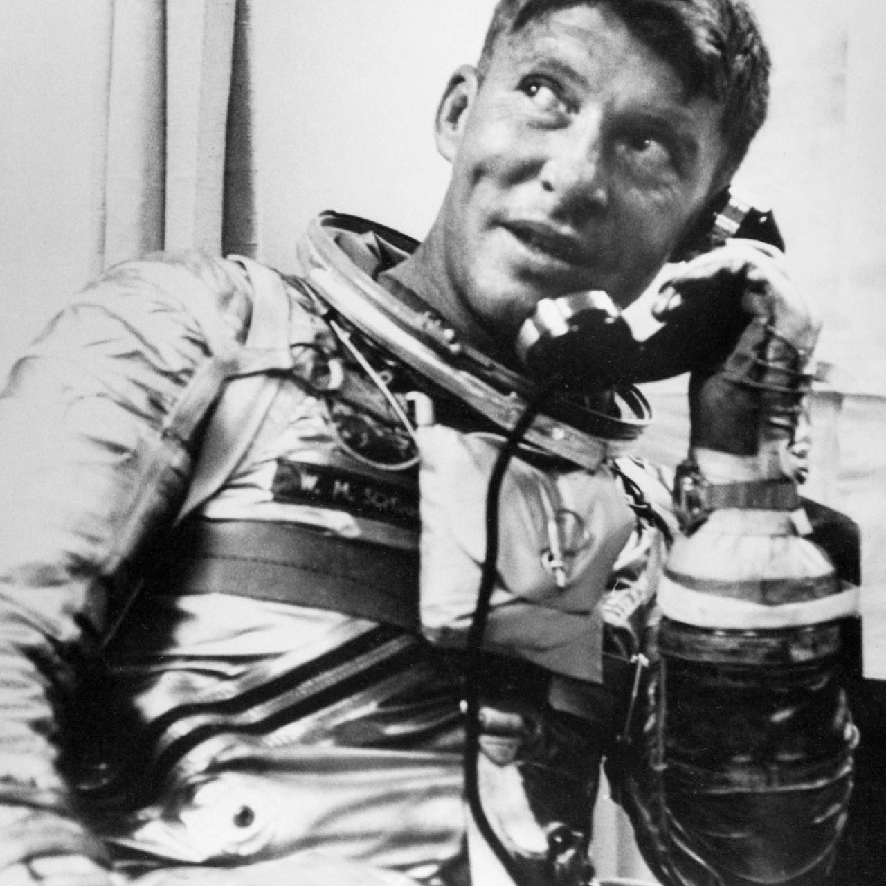 "October 3, 1962 Mercury astronaut Walter ""Wally'"" Schirra orbited the Earth onboard the Mercury-Atlas 8 ""Sigma 7″ mission. During the fifth US manned space mission, Schirra was wearing an Speedmaster CK2998, clearly visible here on the inside of his wrist while talking on the phone onboard recovery ship USS Kearsarge. (Image: NASA)"