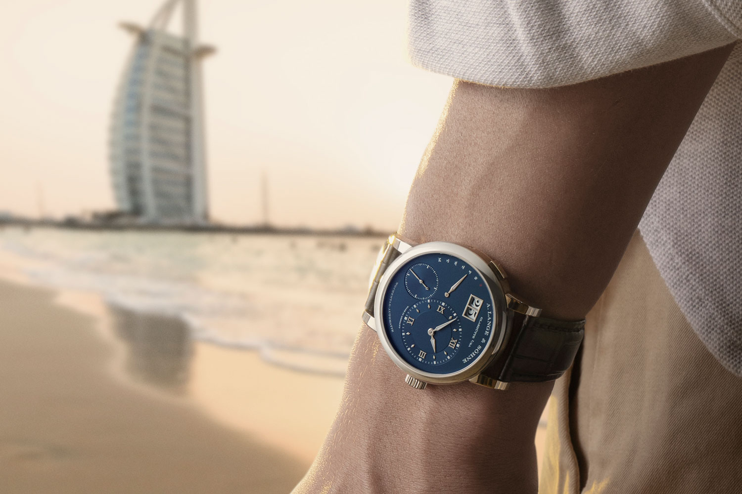 The Lange 1 Daymatic ref. 320.028 at the coast looking out to the Burj Al Arab Jumeirah (Image © Revolution)
