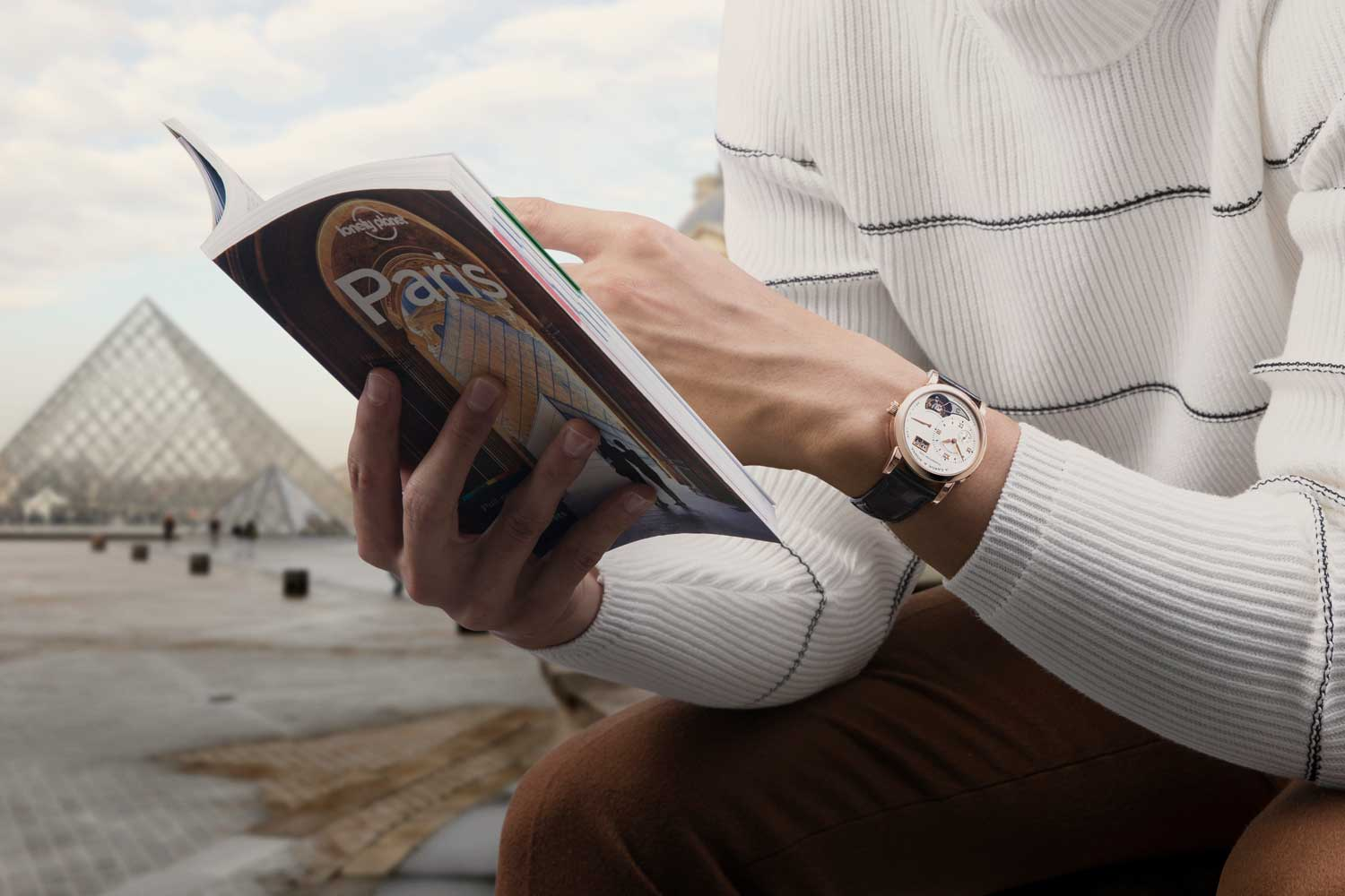 The Lange 1 Tourbillon (reference 704.032 in pink gold) on the Courtyard of the Louvre Museum (Image © Revolution)