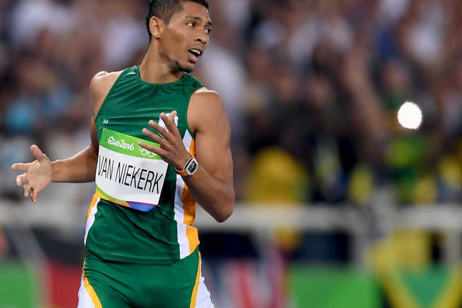 South African sprinter, Wayde van Niekerk breaks the 400m men's record at Rio wearing the RM 27-02