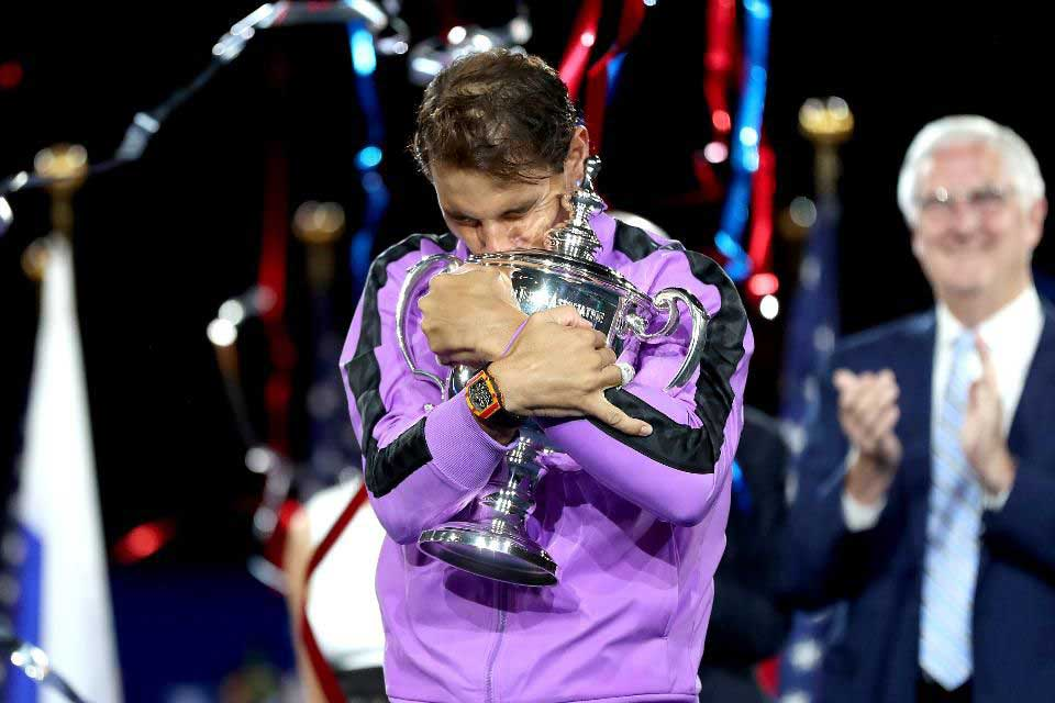 NEW YORK, NEW YORK - SEPTEMBER 08: Rafael Nadal of Spain raises the 2019 US Open Trophy as he celebrates his 19th career Grand Slam win (Photo by Clive Brunskill/Getty Images)
