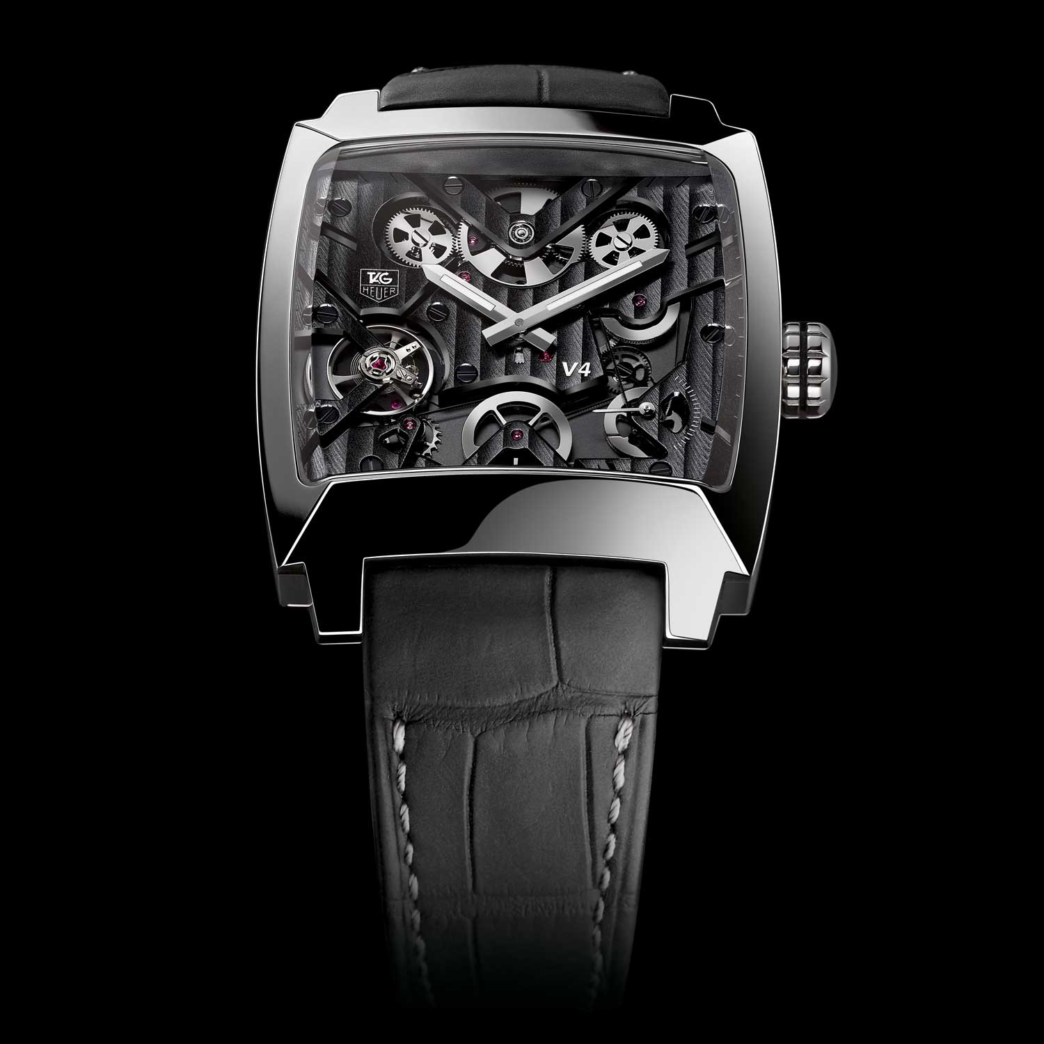 Unveiled as a Concept Watch at BaselWorld 2004, the TAG Heuer Monaco V4, twice patented, is the first watch in the world to feature optimized mechanical transmission belts and a linear winding system. Its bold design is inspired by the legendary Monaco, oversized and square, was first seen on Steve McQueen's wrist in the 1970 film Le Mans