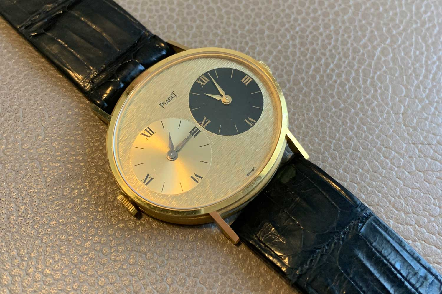 Lot 68: Piaget, Ref. 612501 yellow gold oval-shaped dual-time wristwatch, circa 1973