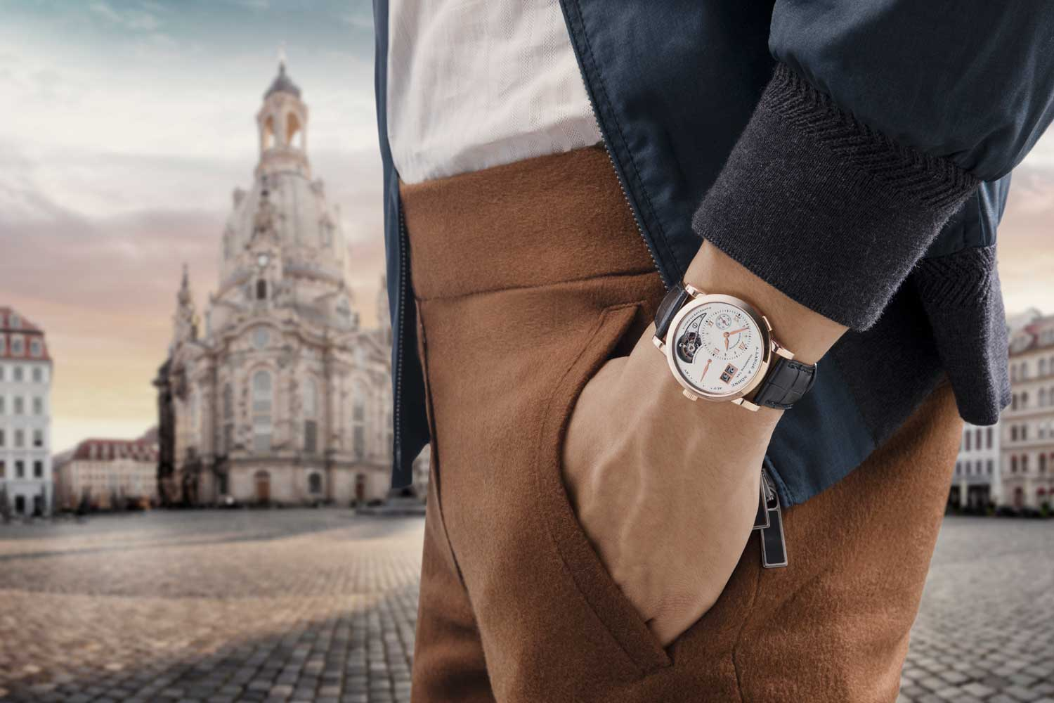 The Lange 1 Tourbillon (reference 704.032 in pink gold) on the Courtyard of Dresden Frauenkirche (Image © Revolution)