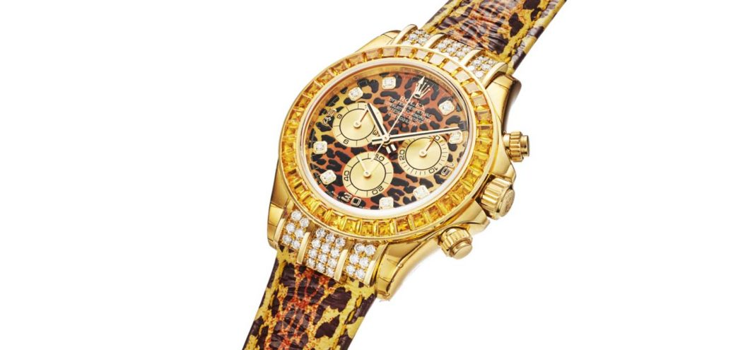 Lot 255: Rolex Ref. 116598, Daytona Leopard 18K Yellow Gold, Diamond and Cognac Sapphire Bezel