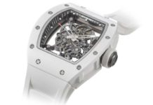 Lot 40: Richard Mille, a very fine and rare titanium and ceramic tonneau-shaped skeletonised wristwatch with sweep centre seconds, warranty, screw driver and box