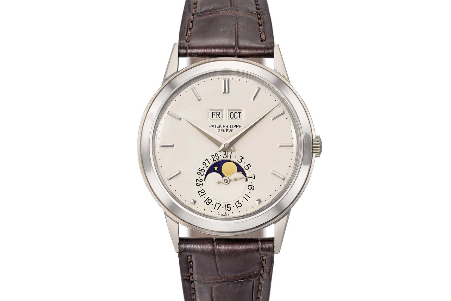 Lot 112: Patek Philippe, an extremely fine, very rare and highly attractive 18k white gold automatic perpetual calendar wristwatch with moonphase and box
