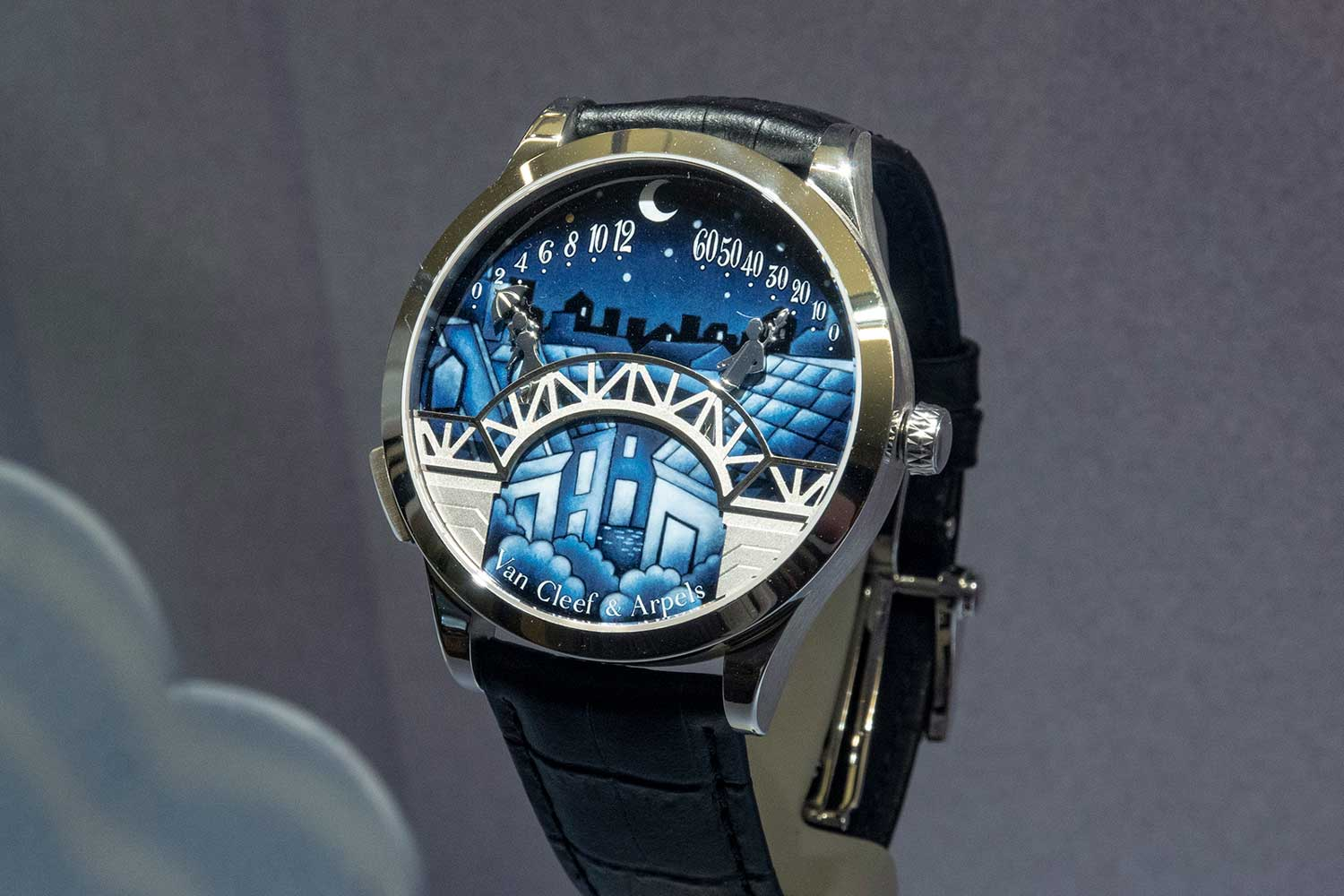 A casual shot of the Pont des Amoureux housed in the Midnight case, sized at 42mm. The retrograde displays are cast wider and the figures are shorter, with a deep blue background for the grisaille enamel than the Lady Arpels model. (Image by Revolution)