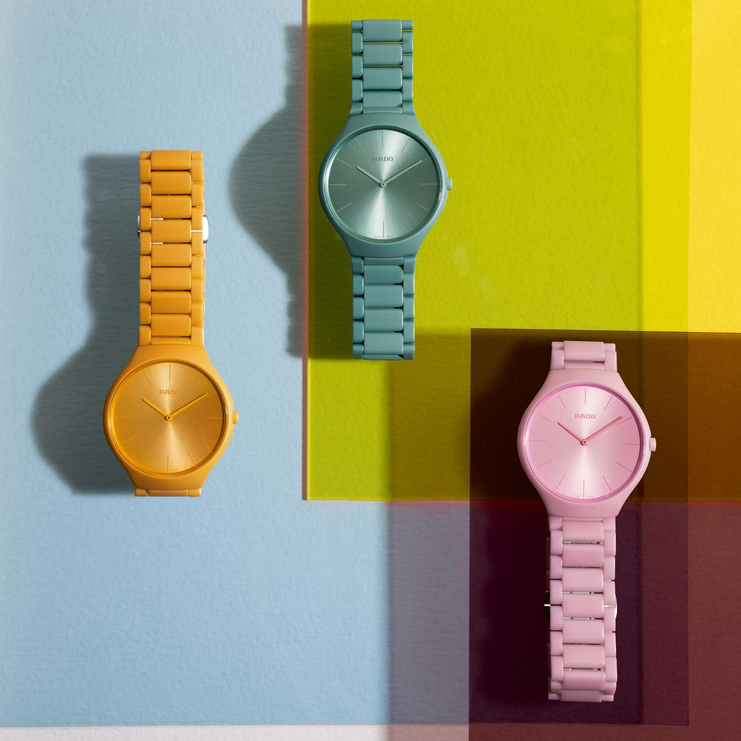 Rado True Thinline Les CouleursTM Le Corbusier Sunshine Yellow 4320W, Slightly Greyed English Green 32041, and Luminous Pink 4320C (Image © Revolution)