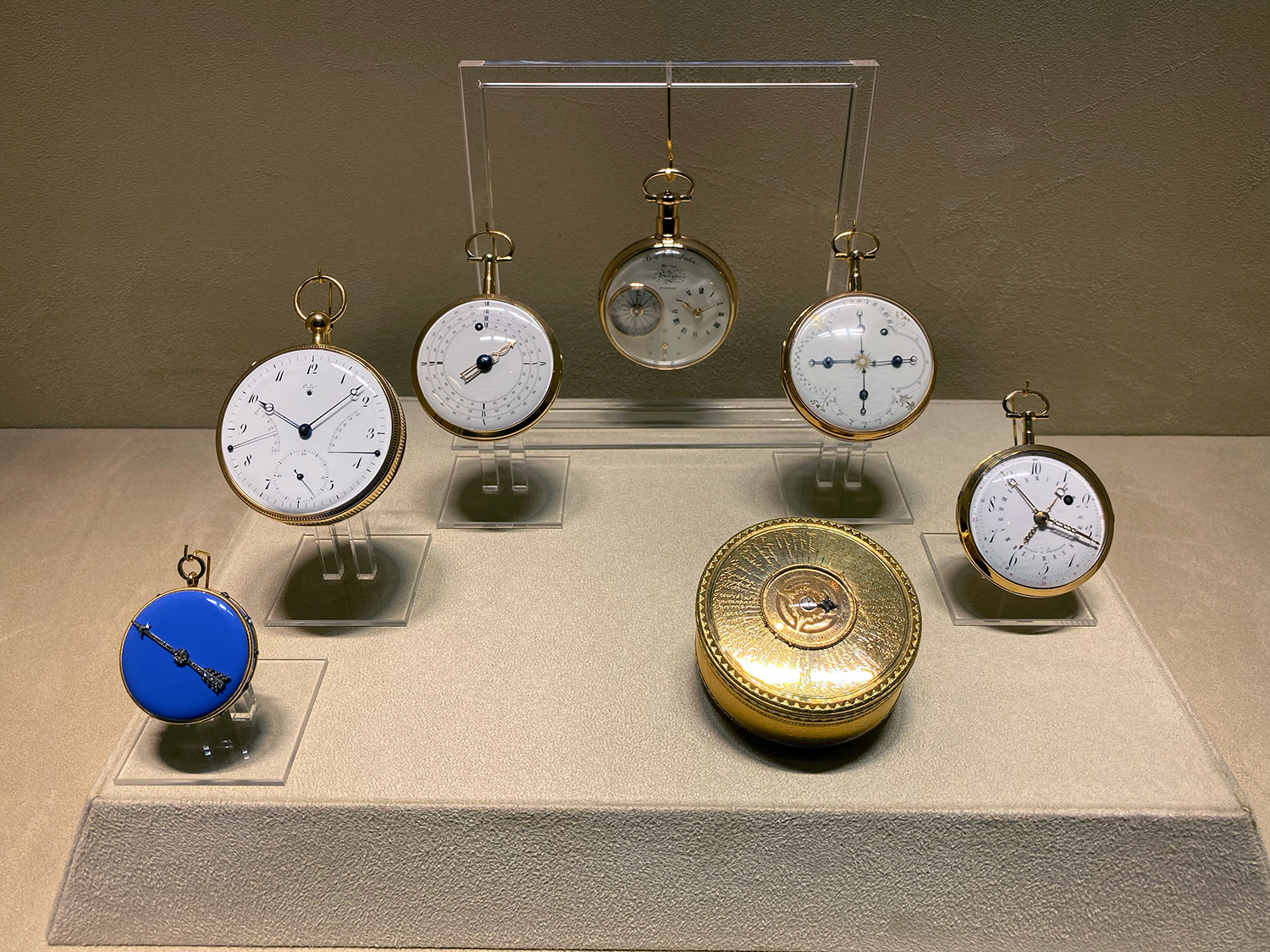 The showcase in the Museum Room displaying the Tactile Hours watch (far left) and the Ten Hour Day watch (far right) mentioned in the podcast