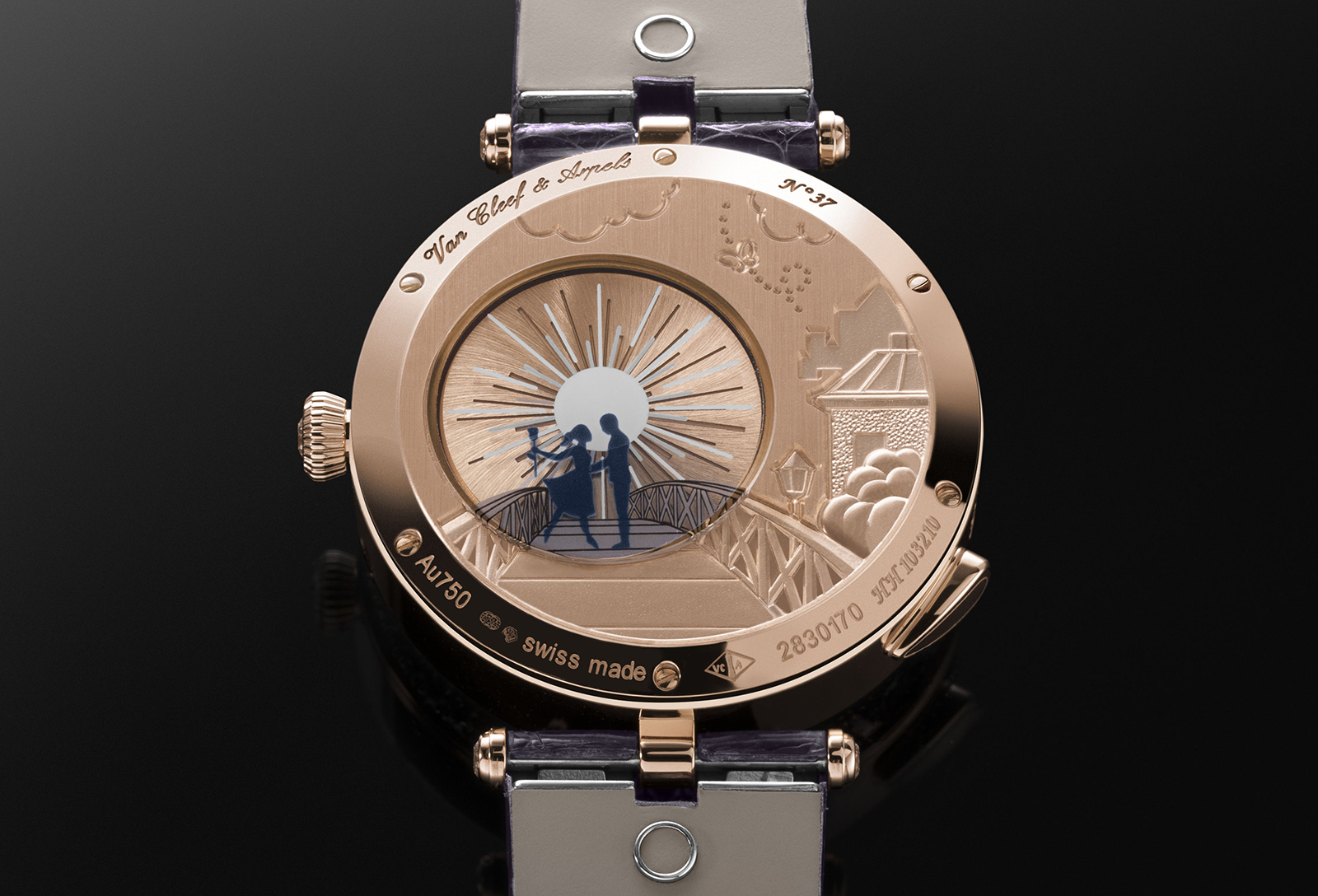 The micro-rotor on the back sits under the sapphire crystal with an enamel tracing image of the lovers meeting on a bridge. The case back is also engraved with an image of the scene on the case. Image by Toh Si Jia / Revolution.
