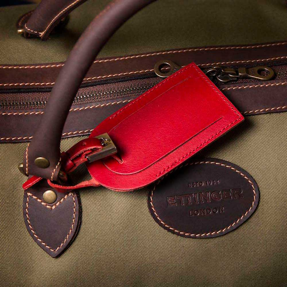 Ettinger's red luggage tag