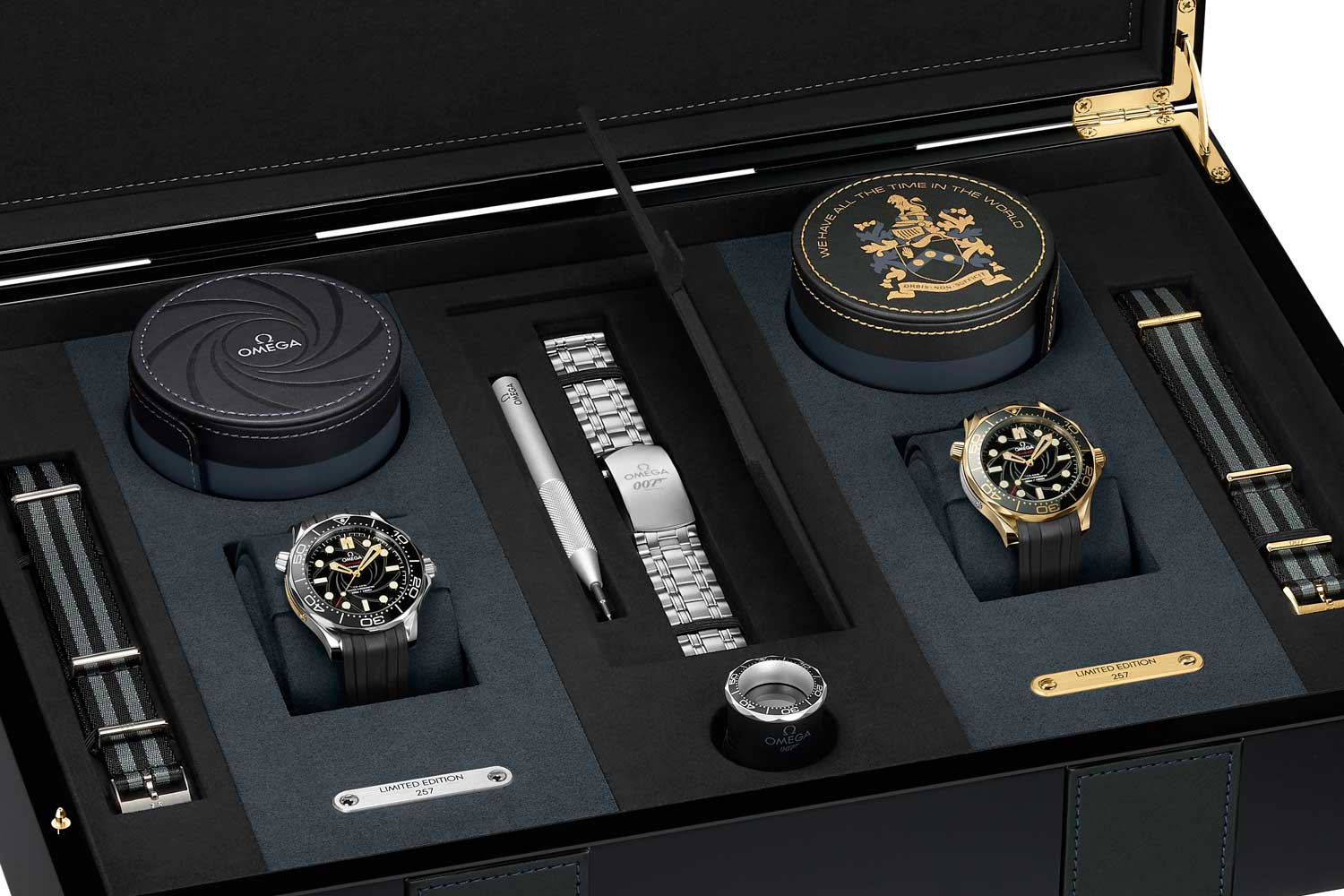 OMEGA James Bond Limited Edition Set including the 42mm stainless steel and 18K yellow gold Seamaster Diver 300M watches with additional NATO straps, a stainless steel bracelet and carrying cases