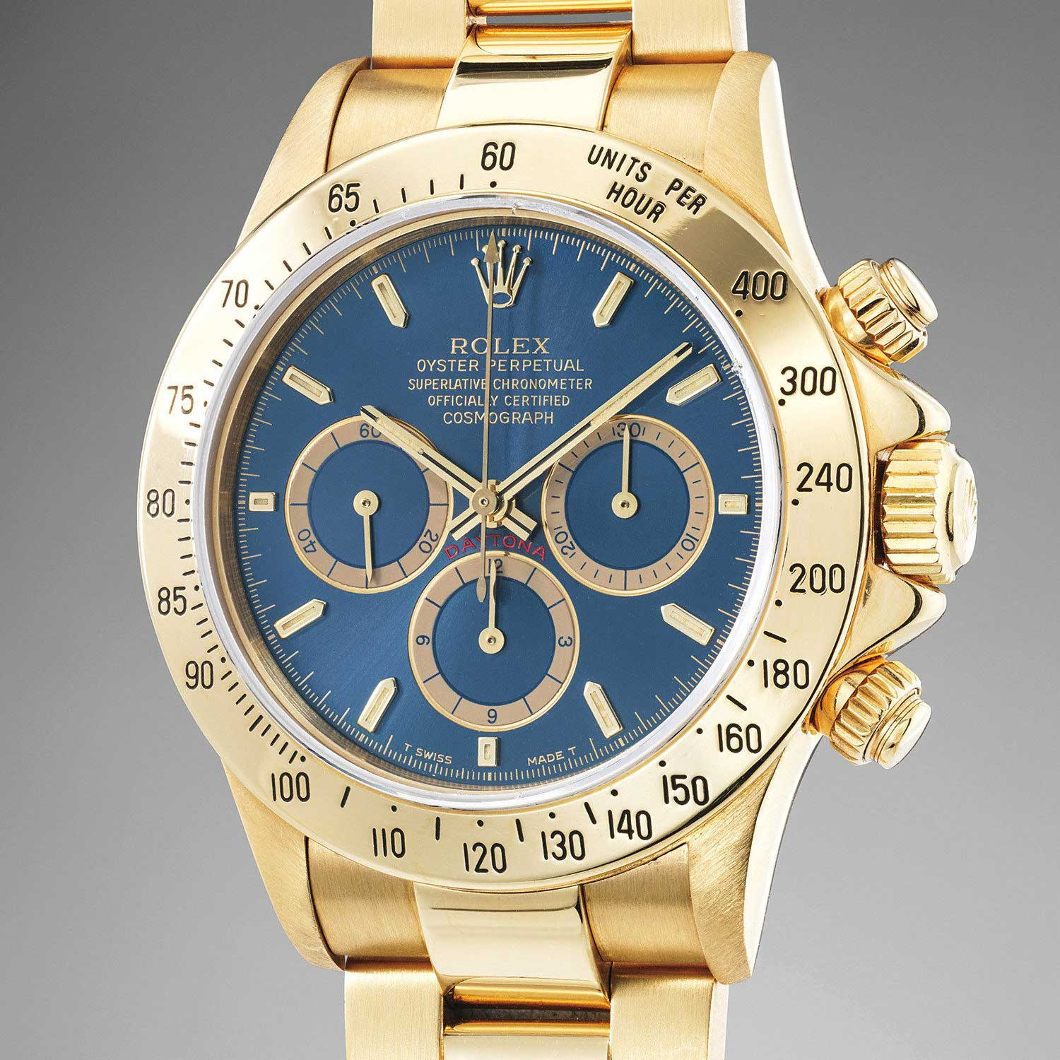 Lot 173: Rolex Ref. 16528. An extremely rare and highly attractive yellow gold chronograph wristwatch with blue dial and bracelet