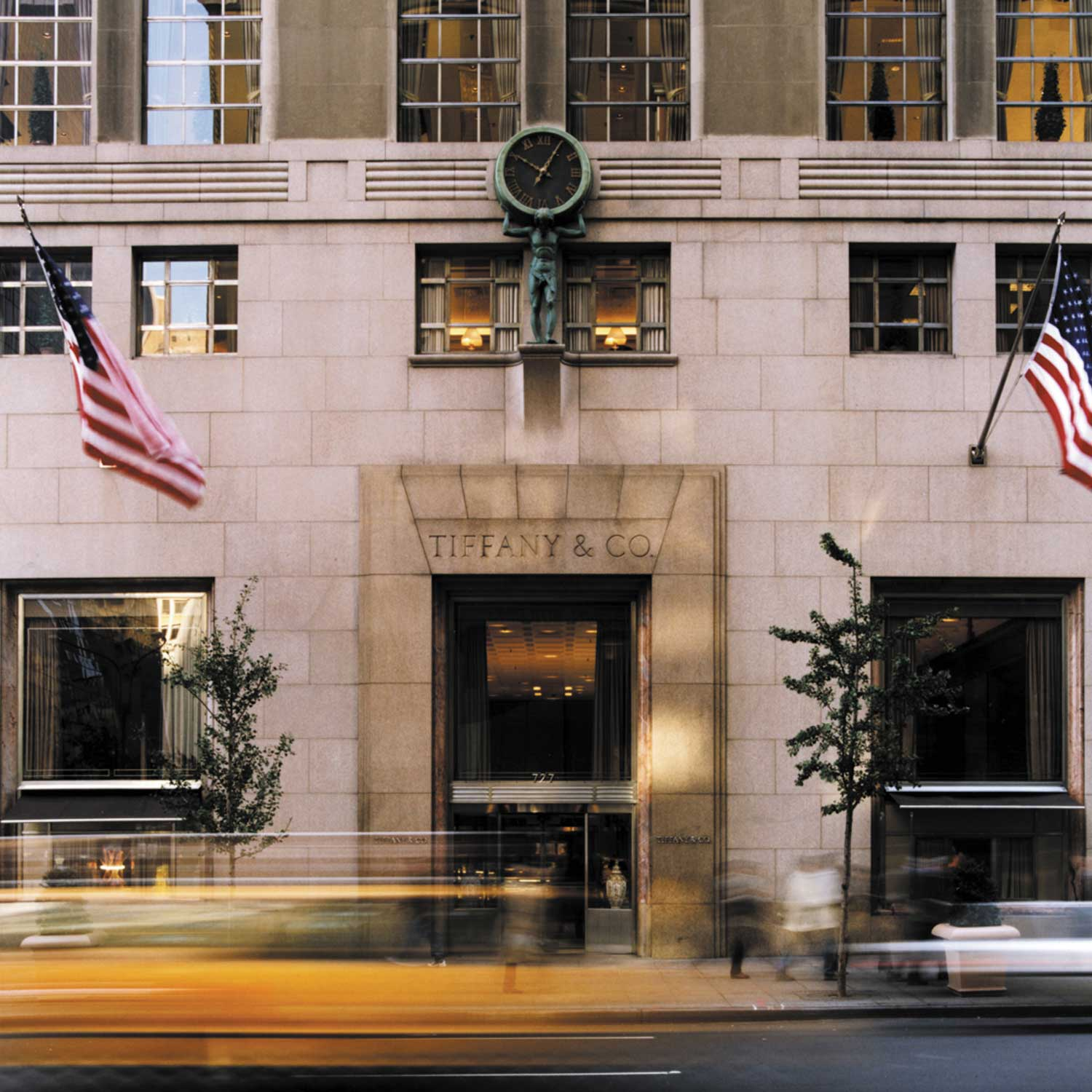 In 1940, Tiffany & Co. moved to its current location at 727 Fifth Avenue, at the corner of Fifty-seventh Street. The granite and limestone building, with Art Deco influences and stainless steel doors, is adorned with a nine-foot bronzed figure of Atlas shouldering a clock (Photography by © Andrew Bordwin)