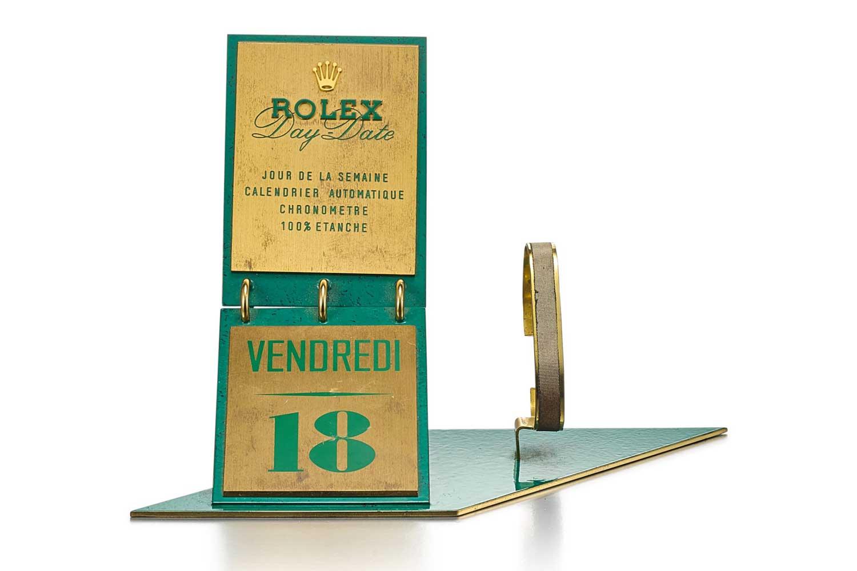 Lot 8098: Rolex - Day-date, a gilt brass and green enamel retailer's window display, circa 1960