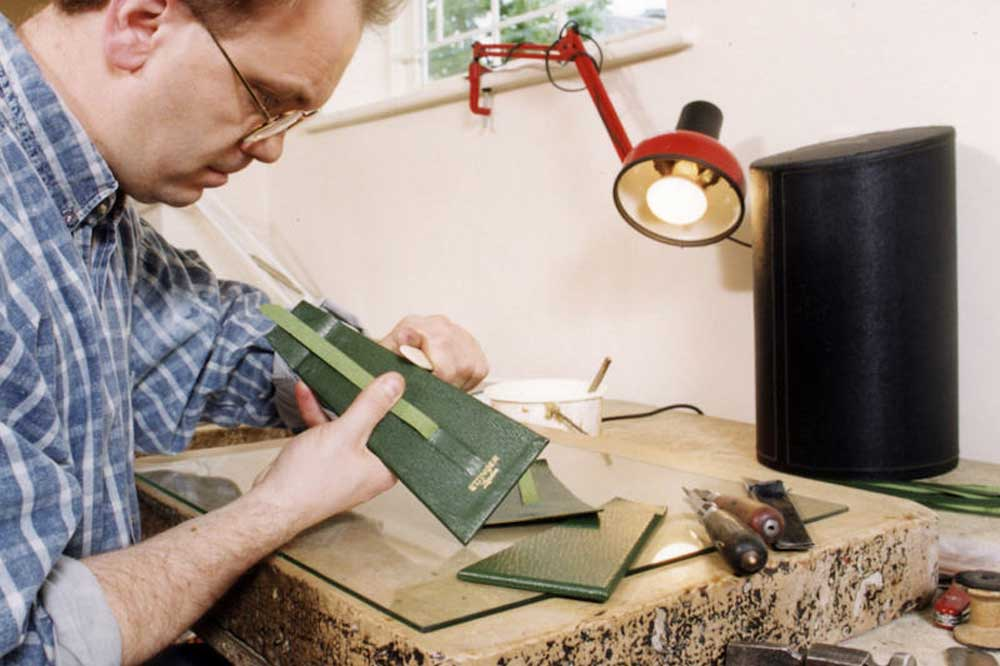 An artisan working in Ettinger's factory in Walsall