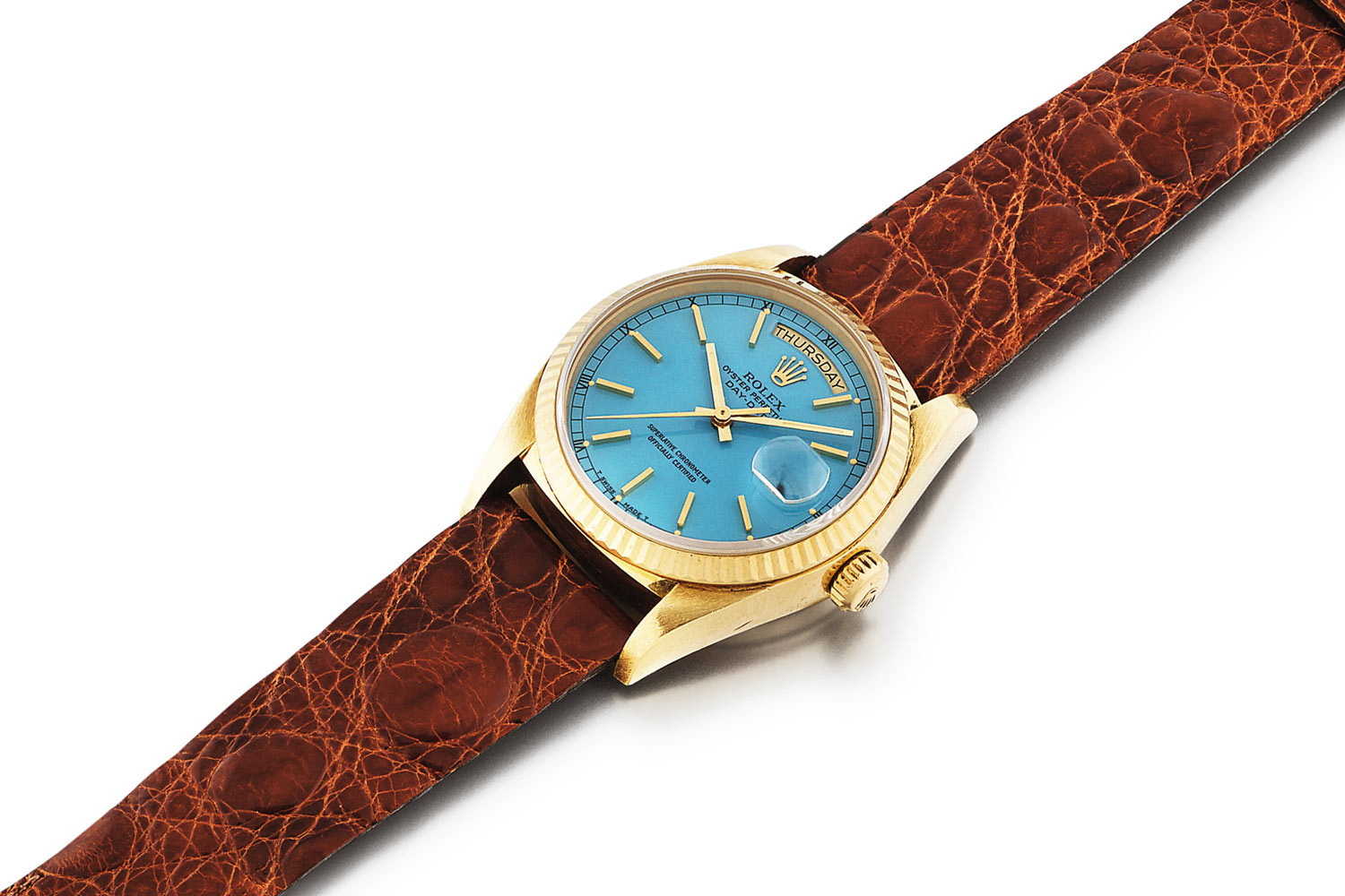 Lot 383: Rolex 'Stella' Day-Date Ref. 18038. Yellow gold wristwatch with day, date and blue Stella dial, circa 1986