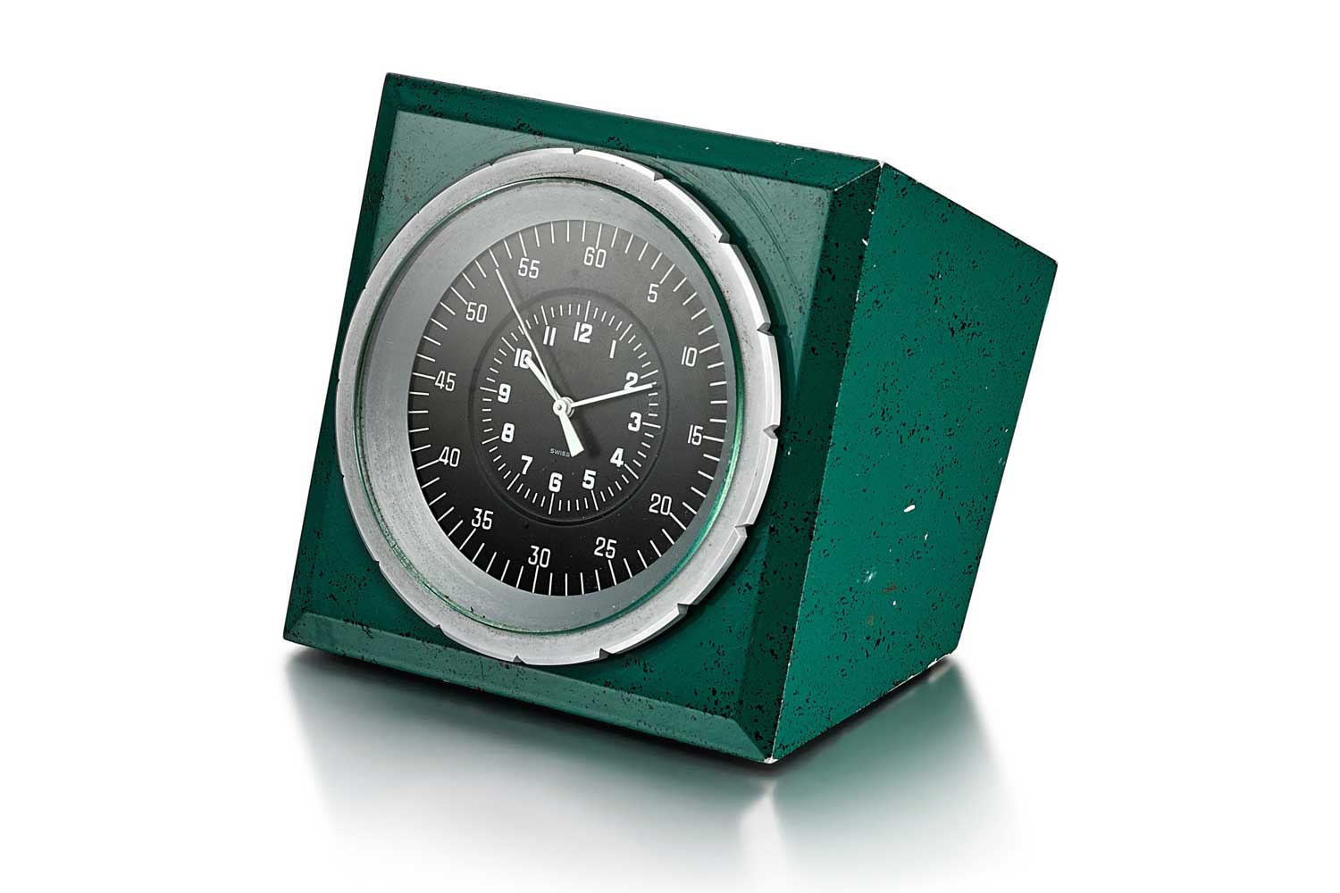 Lot 8089: Patek Philippe for Rolex - A Green Painted Metal Electric Desk Clock, Circa 1970