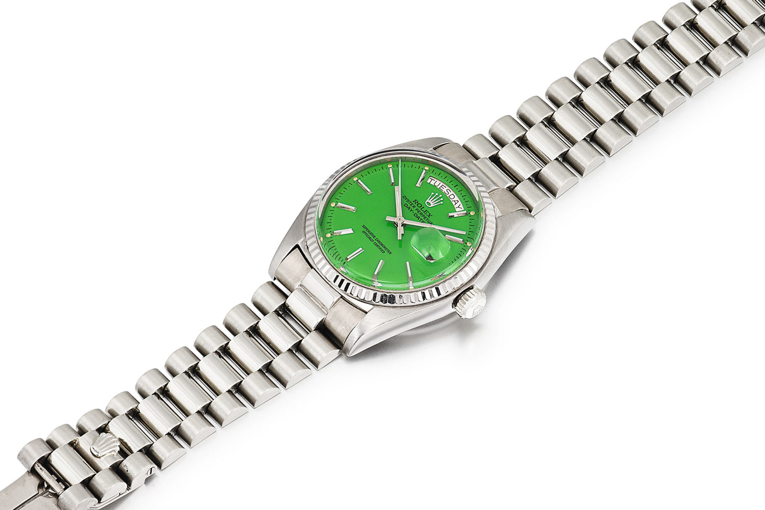 Lot 384: Rolex 'Stella' Day-Date Ref. 1803. White gold wristwatch with day, date and green Stella dial, circa 1974