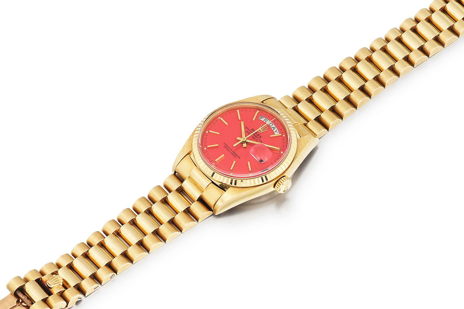 Lot 386: Rolex 'Stella' Day-Date Ref. 1803. Yellow gold wristwatch with day, date and red Stella dial, circa 1975