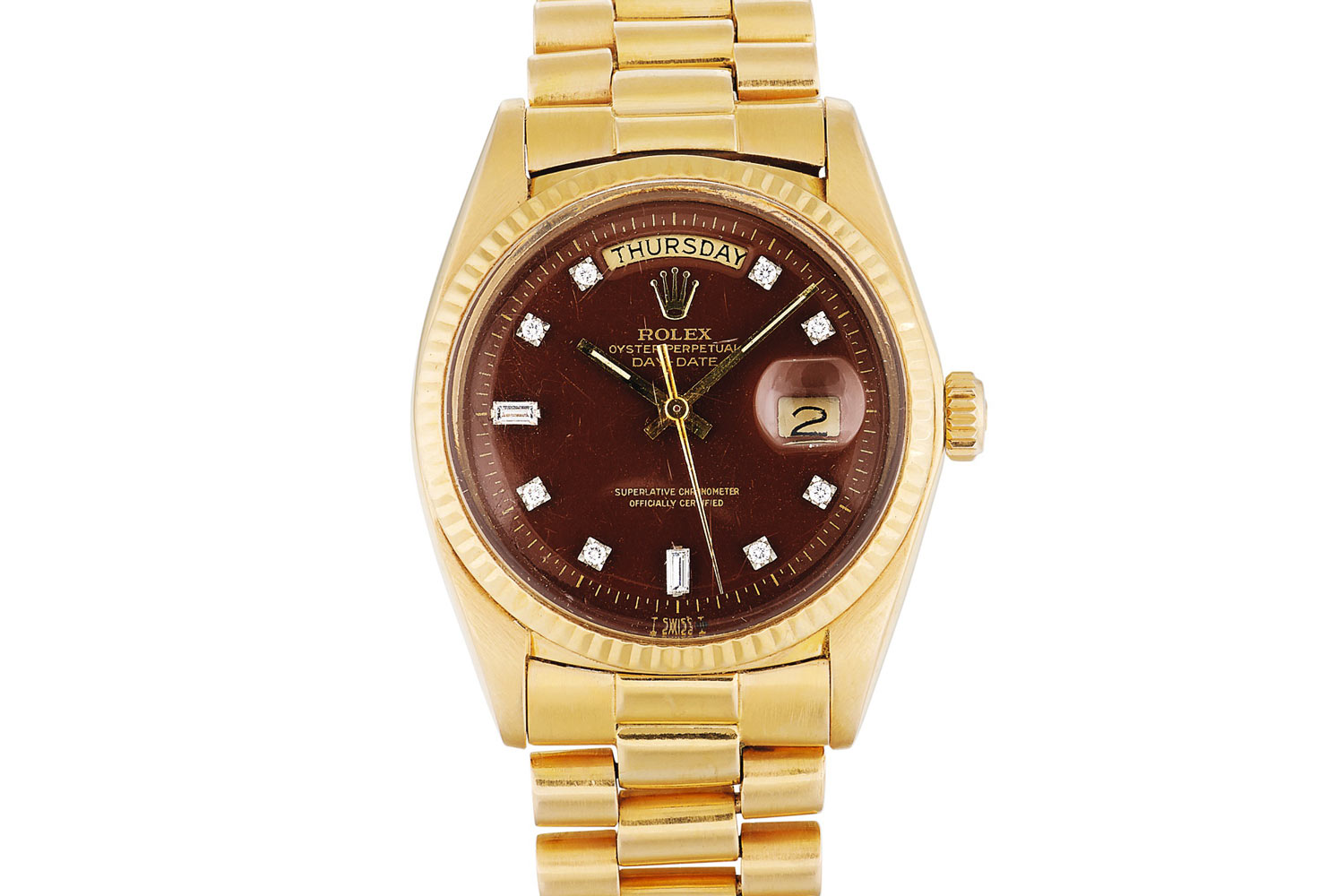 Lot 387: Rolex 'Stella' Day-Date Ref. 1803. Pink gold and diamond-set wristwatch with day, date and burgundy Stella dial, circa 1973