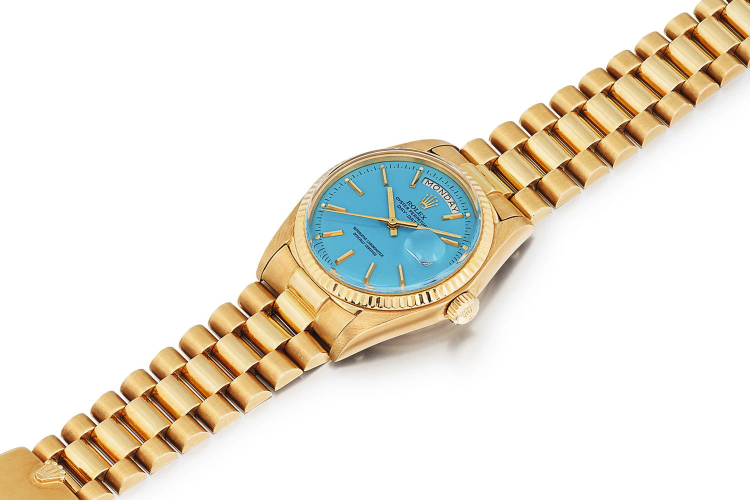 Lot 388: Rolex 'Stella' Day-Date Ref. 1803. Yellow gold wristwatch with day, date and blue Stella dial, circa 1975
