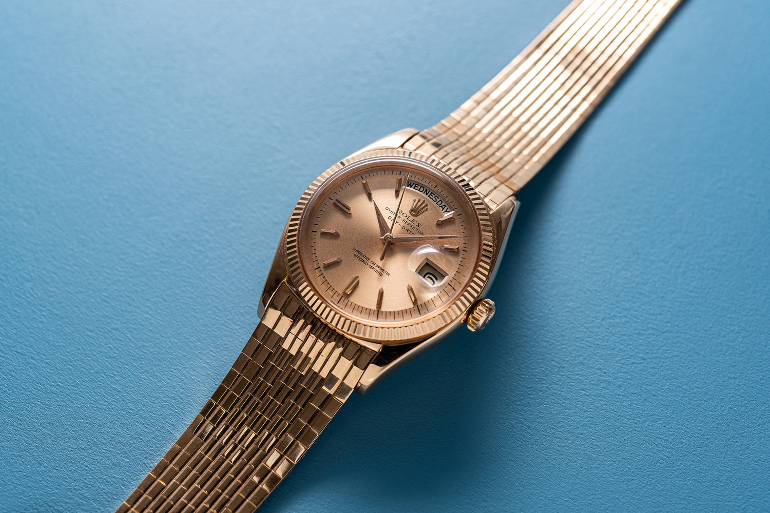 Lot 243: Rolex Ref. 1803. A very rare and impressive pink gold wristwatch with center seconds, day, date and brick link bracelet (Image: Chris Beccan)