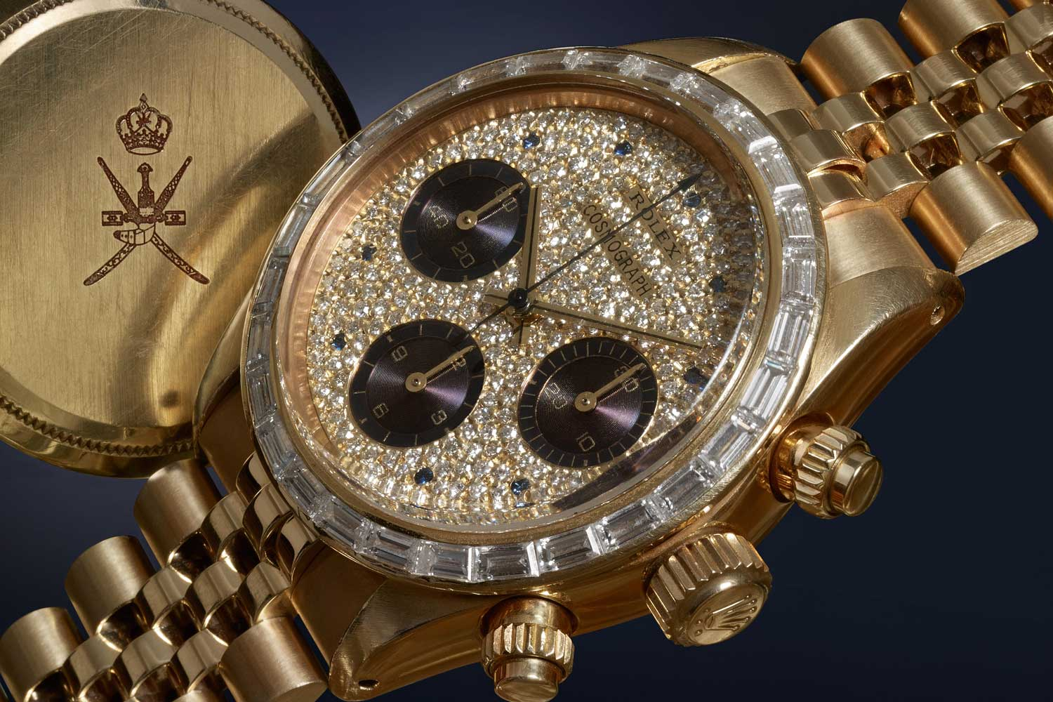 Ref. 6270 fitted with baguette-cut diamonds on the bezel and a fully paved dial with sapphire hour markers and purple counters