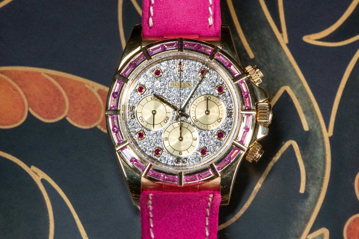 A RUBI edition Daytona with baguette-cut rubies, a fully paved dial and ruby hour markers