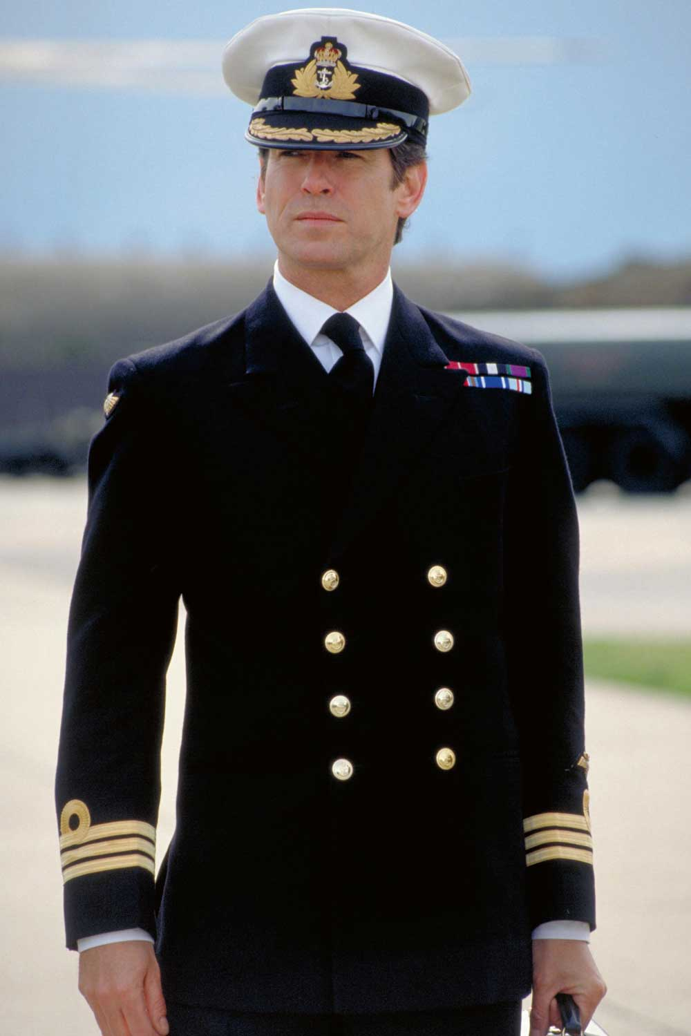 Pierce Brosnan in navy formal blues as Commander Bond