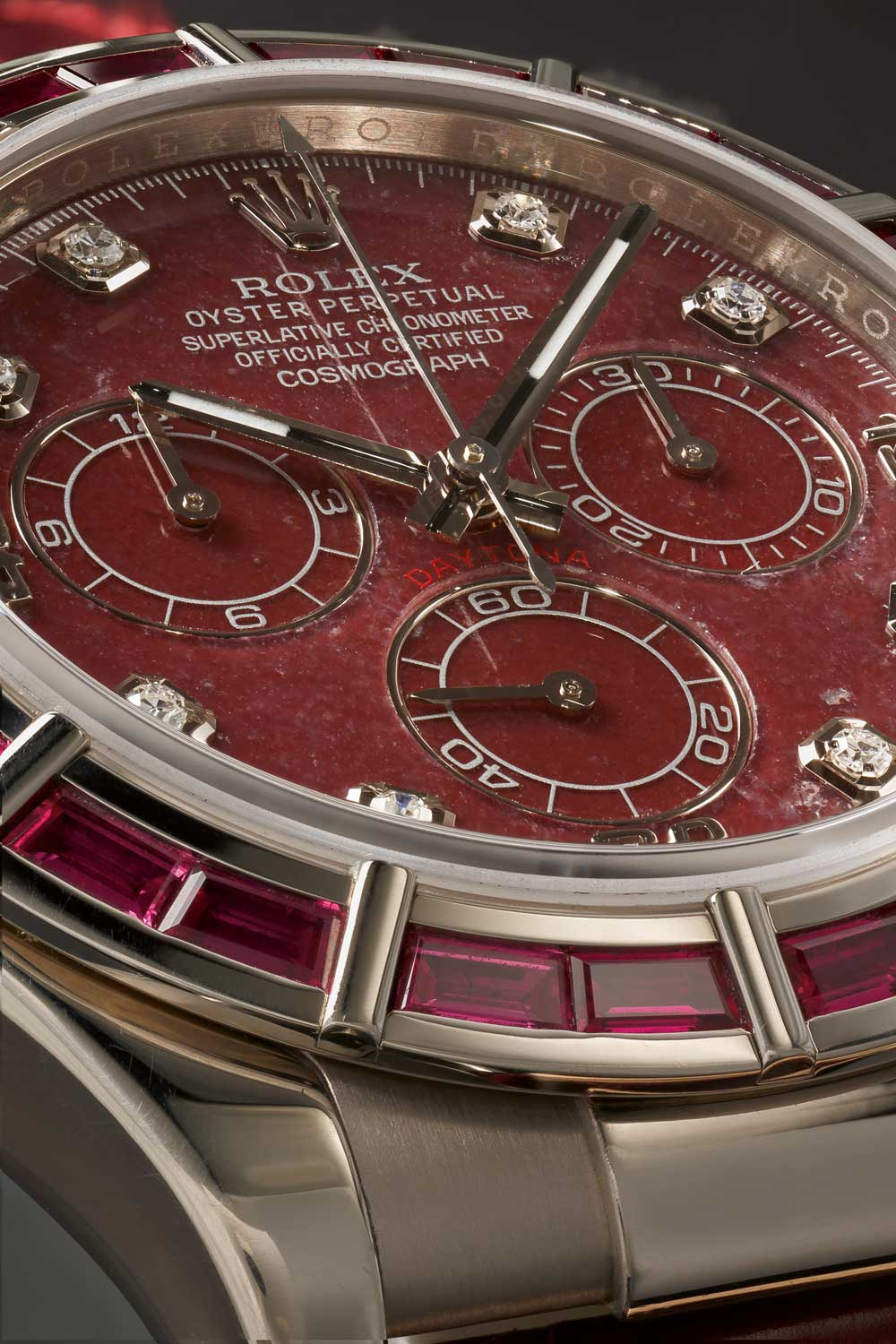 A Daytona with grossular dial and baguette-cut rubies on the bezel