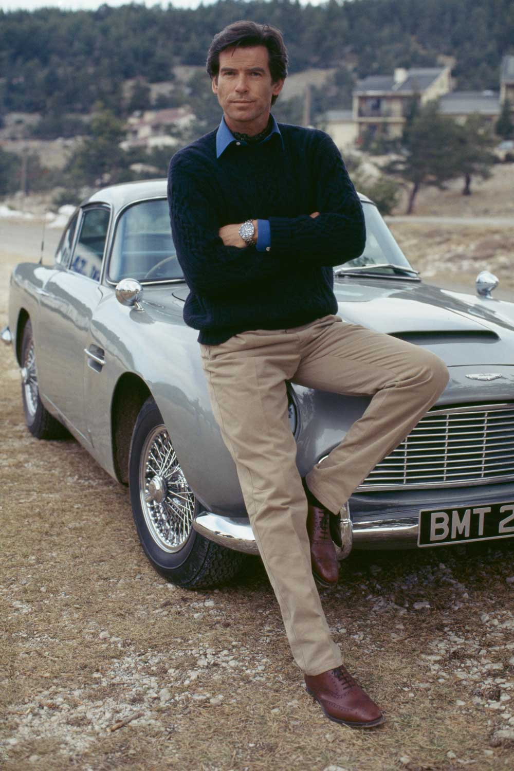 Brosnan with an Aston Marin DB5 on a publicity run for GoldenEye